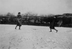 Women throwing snowballs