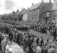 brass band marching through Bedlington Front Street. 1952.JPG