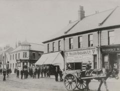 Station Road-Woodhorn Road, Ashington with Arrowsmiths on the corner next to Hillers' Bazaars Ltd.1930.JPG
