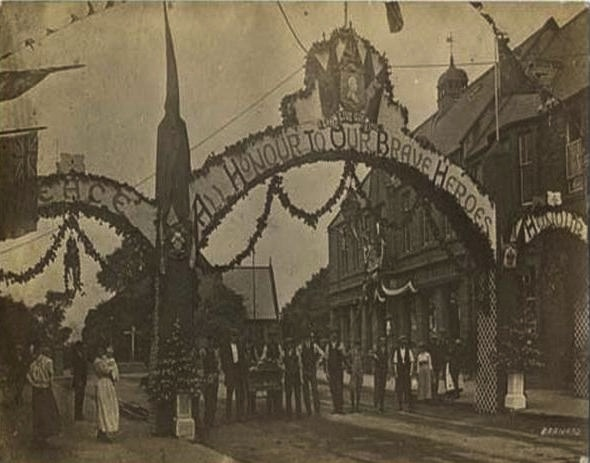Postcard view of the peace arch next to the Co-op, Station Road, Ashington 1919.JPG