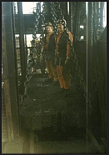 RUSSELL AND HES MARRA ON TOP OF THE CAGE DOING SHAFT INSPECTION