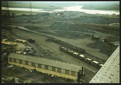 COAL STORAGE AREA - FACE CHOCK REPAIR SHED IN FOREGROUND