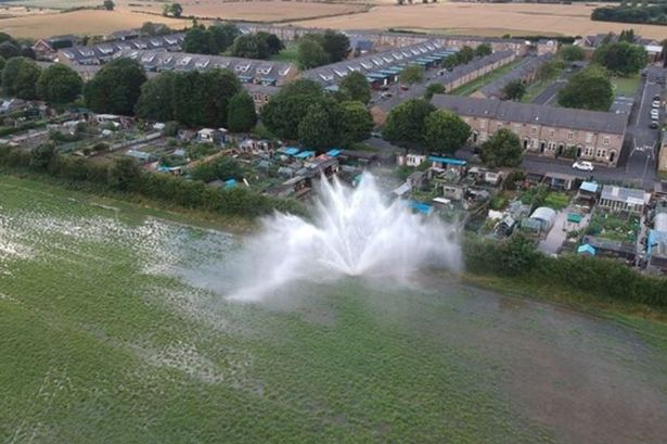 Incredible drone footage shows burst pipe sending 20ft jet of water into the air