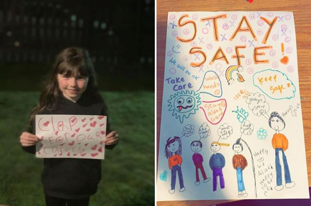 Girl's 'rainbow of hope' posters move neighbours to tears